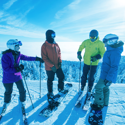 Group of skiers enjoying a moment on the mountain.