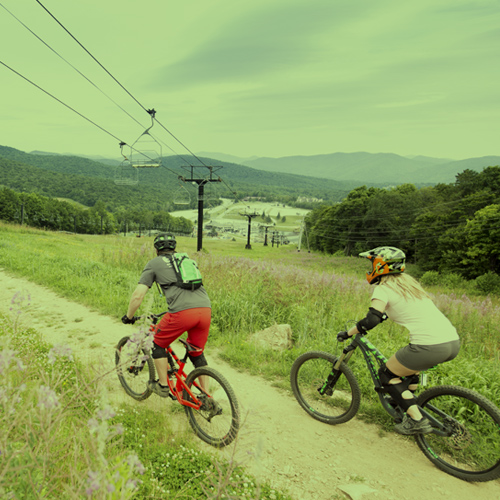A begginer mountain biker takes in a lesson and a view at Killington Resort.